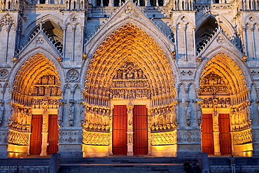 Night view Ornate doorway of the Cathedral of Notre Dame, from XIII Century, in Amiens listed as World Heritage by UNESCO Its the Highest ghotic cathedral of France