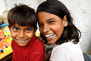 Big smile! Indian siblings smiling together.
