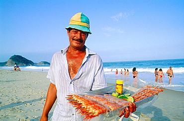 Prawn skewers seller, Ipanema beach, Rio de Janeiro, Brazil