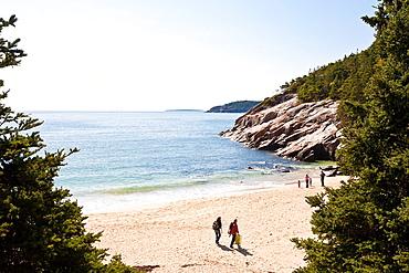 Tourists visit Sand Beach in Acadia National Park near Bar Harbor, Maine