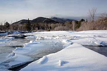 Swift River during the winter months This river travels along side of the Kancamagus Highway route 112 which is one of New Englands scenic byways in the White Mountains, New Hampshire USA This area was part of the Swift River Railroad, which was an log