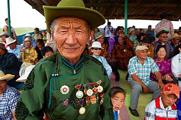 Mongolia, Bulgan province, Naadam festival, man with communism time medals