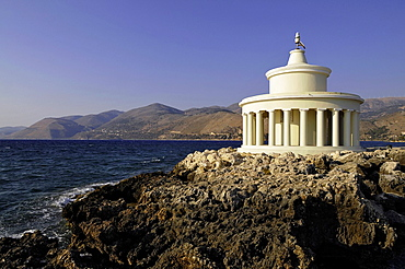 The Agios Theodoros lighthouse at the entrance to Argostoli bay The original lighthouse was built by Charles Napier, in the 1820s and rebuilt to the same design after an earthquake in 1875