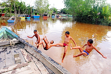 A group of Iban Dayak children swimming on the River near Pusa in Sarawak, northwest Borneo, Malaysia, Southeast Asia, Asia