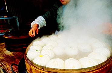 Cooking Dim Sum in a popular market by a canal, Suzhou, Kiangsu province, China