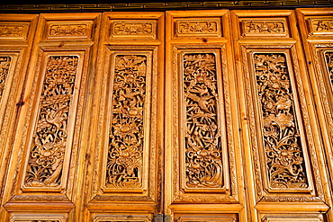 Carved wooden doors on a building in Dayan old town, Lijiang, Yunnan Province, China