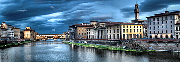 Panoramic view on old houses, Arno river and Ponte Vecchio at evening in Florence, Italy