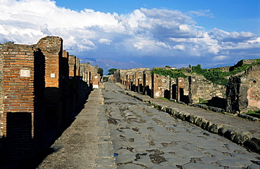 Looking down a paved street at the historic site of Pompeii, Italy