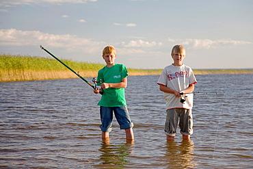 Two Teenage Boys Fishing by Lake Võrtsjärv in Estonia