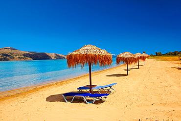 Beach & sunbeds on Agrostoli Bay near Lixouri, Kefalonia, Ionian Islands, Greece