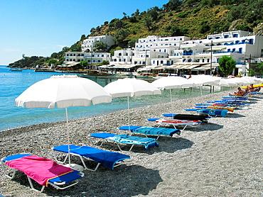 Sunbeds and Umbrellas on the beach, Loutro, South Crete, Greece