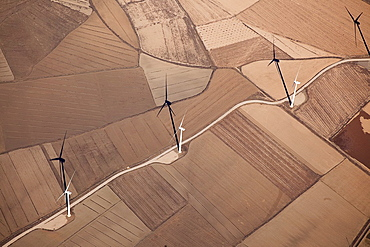 Fields of wind farms seen from the sky on farmland