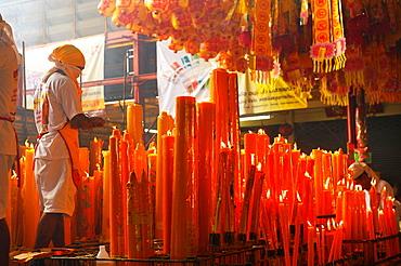 candles lighted for good luck and prosperity, Vegetarian festival at San Jao Sieng Kong shrine, wat sung heng yee, Chinatown, Bangkok,