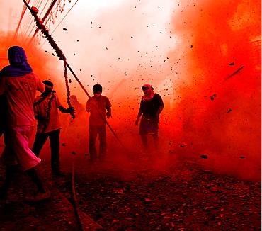 firework madness, devotees come under fire during a temple run, firework madness, phuket vegetarian festival, phuket, thailand