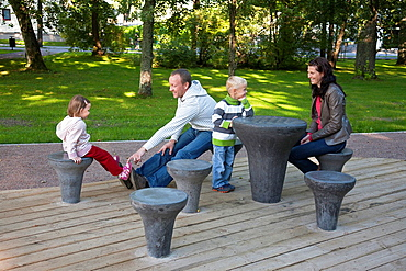 Young Family Sitting in Park, Chess Grounds in Parnu Rannapark, Estonia, Europe