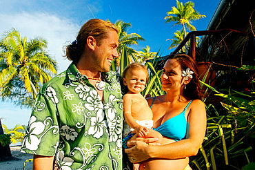 Teva Victor, son of Paul-Emile Victor, with family on an islet named 'Private island' where he runs a rental house, Bora Bora island, French Polynesia , South pacific (editorial only)
