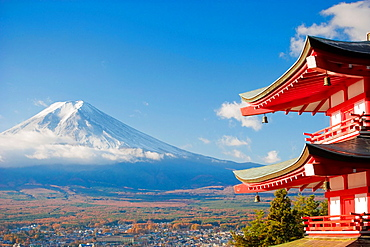 Pagoda overlooking Mount Fuji and Fujiyoshida city, Japan