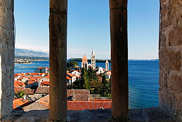 View of Rab Town through arch of Roman bell tower in Rab, Croatia, Europe