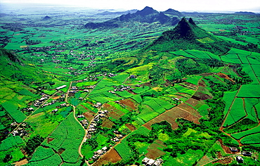 Island of Mauritius in the Indian Ocean Aerial view of central basaltic peaks and sugar cane plantations Ile Maurice