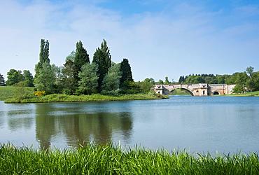 Blenheim Palaces lake and Grand Bridge in Oxfordshire England United Kingdom Europe