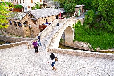 Bridge crossing Radobolja river Stari Grad old town Mostar city Bosnia and Herzegovina Europe