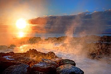 Sunset, lava and steam Area close to the Hitaveita Sudurnesja Geothermal power plant, Iceland