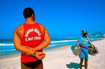 Life guard on duty & old tea seller, Ipanema, Rio de Janeiro, Brazil