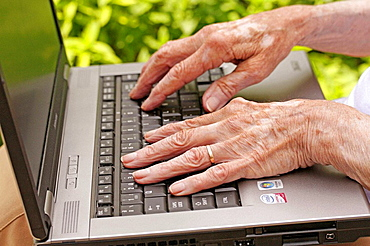 Old woman and laptop