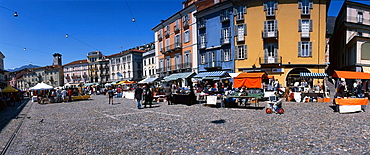 Switzerland, Locarno, town, city, city center, Old Town, Piazza grandee, tourist, market, persons, canton Ticino, place, space, make purchases, marketplace, panorama. Switzerland, Locarno, town, city, city center, Old Town, Piazza grandee, tourist, market, persons, canton Ticino, place, space, make purchases, marketplace, panorama