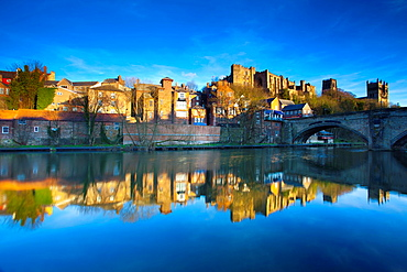 England, County Durham, Durham City Bridge over the River Wear in the city of Durham, with Durham Castle, Cathedral and city reflected upon the still water face