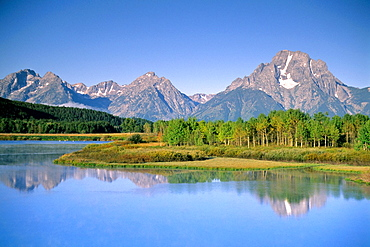 Mount Moran reflected in Clear blue sky and waterof the Snake River at Oxbow Bend, Grand Teton National Park, Wyomingt