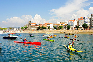 Sea kayak race in Bouzas, vigo, Spain