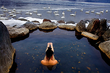 Woman in outdoor rotemburo or onsen, Lake Kussharo, Akan National Park, Hokkaido, Japan