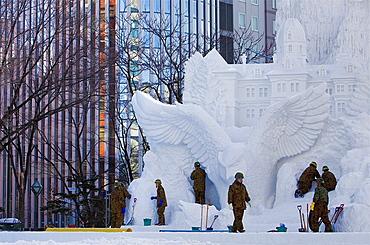 Army collaborating in the preparation of the Sapporo snow festival, snow sculptures, Odori Park, Sapporo, Hokkaido, Japan