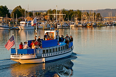 Sunset cruise on historic Madeket tour boat, oldest vessel in continuous operation in California, Humboldt Bay, Eureka California