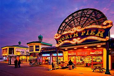 North Pier main entrance at night showing games and slot machines, Blackpool, Lancashire, England, UK