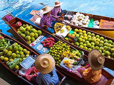 Fruit seller in the Damnoen Saduak floating market, 100 km away from Bangkok Thailand