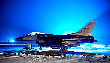 Floodlights illuminate an F-16 Fighting Falcon outside a hardened aircraft shelter at Misawa Air Base, Japan, Jan  19, 2010  Flightline operations continue into the night to keep the base´s F-16s, pilots and maintenance crews ready to deploy at a moment´s