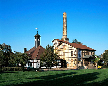 Germany, Halle (Saale), Saale, nature reserve Lower Saale Valley, Saxony-Anhalt, Halloren and Saltworks Museum accomodated in the buildings of the former Prussian Royal Saltwerks, half-timbered houses, chimney, smoke stack