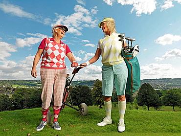 Mature ladies playing golf, Mature ladies playing golf