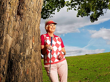 Mature lady playing golf, Mature lady playing golf