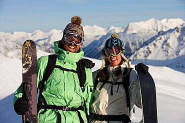 Portrait of a couple on a ski vacation, Portrait of a couple on a ski vacation