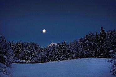 Full Moon over snowfield, Full Moon setting over snowy landscapeMountain sceneThe Alps