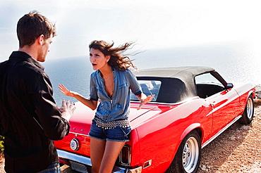 couple arguing next to car