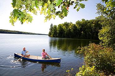 Senior couple in canoe, Senior couple in canoe
