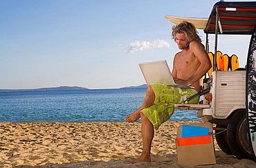man at beach jeep with laptop, phone, man at beach jeep with laptop, phone