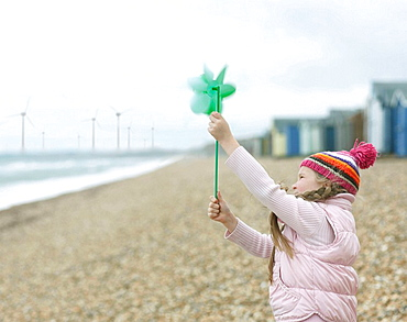 young Girl with Windmill on Beach, young Girl with Windmill on Beach