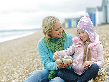 Mother and Daughter together on beach, Mother and Daughter together on beach