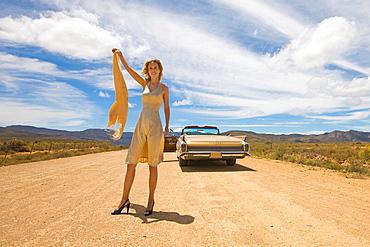 Helpless woman in desert, Female driver, car break down, flat tyre, desert