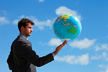 Businessman holding globe, Businessman holding globe